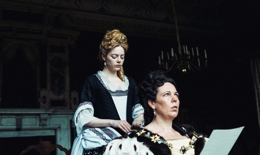 Emma Stone is a solicitous maid who social climbs by flattering Queen Anne (Olivia Colman)