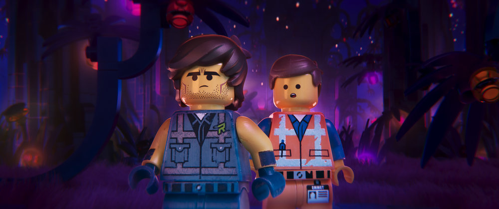 Rex Dangervest (voiced by Chris Pratt) meets Emmet (voiced by Chris Pratt) in The Lego Movie 2