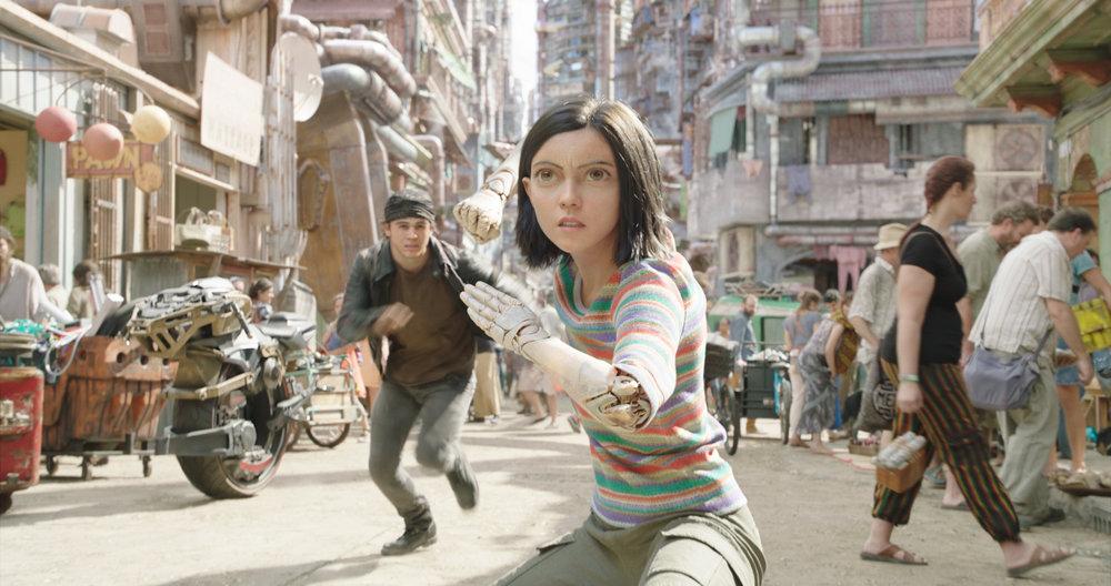 Keean Johnson and a cyborg-iced Rosa Salazar fight their way through Iron City in Alita: Battle Angel.