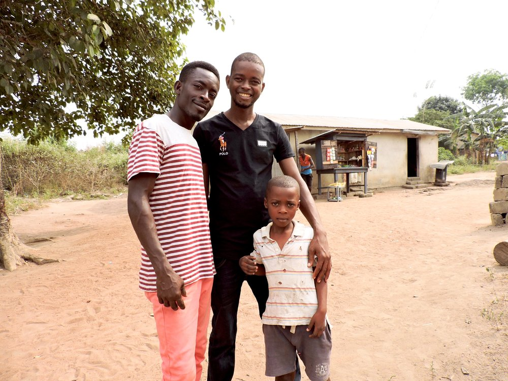 Stephen (in the middle), his brother, and a little boy on the way to the orphanage