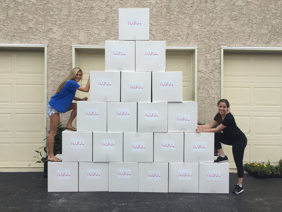 Kelsey and Jenna with a shipment of sanitary Materials