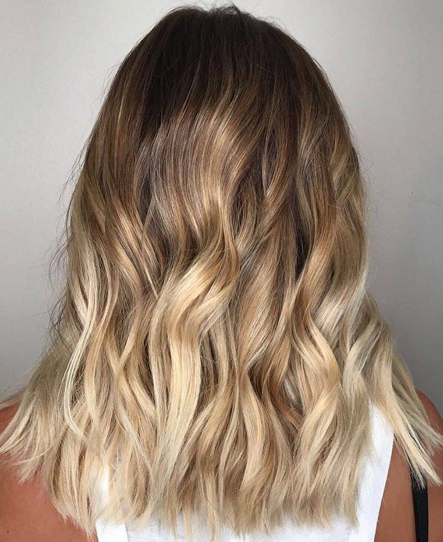 color melt balayage highland village hair salon.jpg