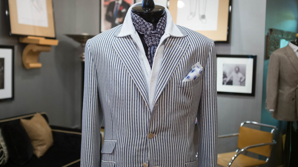 Paired with beach trunks or styled under a lightweight summer sportcoat, the white terry-cloth cardigan front takes you straight from the waterfront to dinner in town.