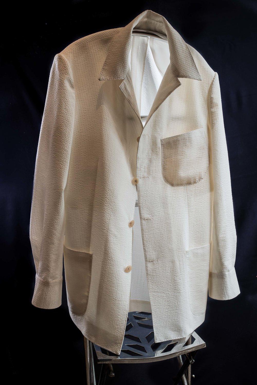 Brochure cover images: Bespoke slack jacket in 7oz wool and silk seersucker.