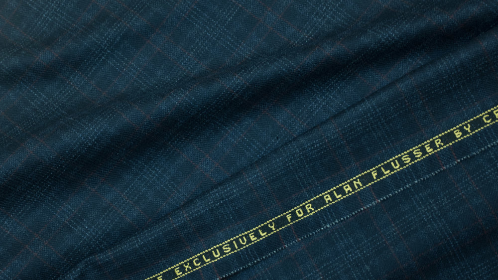 Alan conceived of this 10½ oz flannel as an alternative navy blazer. Its subtle, abstracted glen plaid offers considerably greater depth and visual interest while remaining as easy and versatile to wear as its solid navy cousin. Like any blazer, it can be finished with brass or gunmetal buttons for a blue-blooded Anglo look, or horn buttons for a more casually Italian effect.