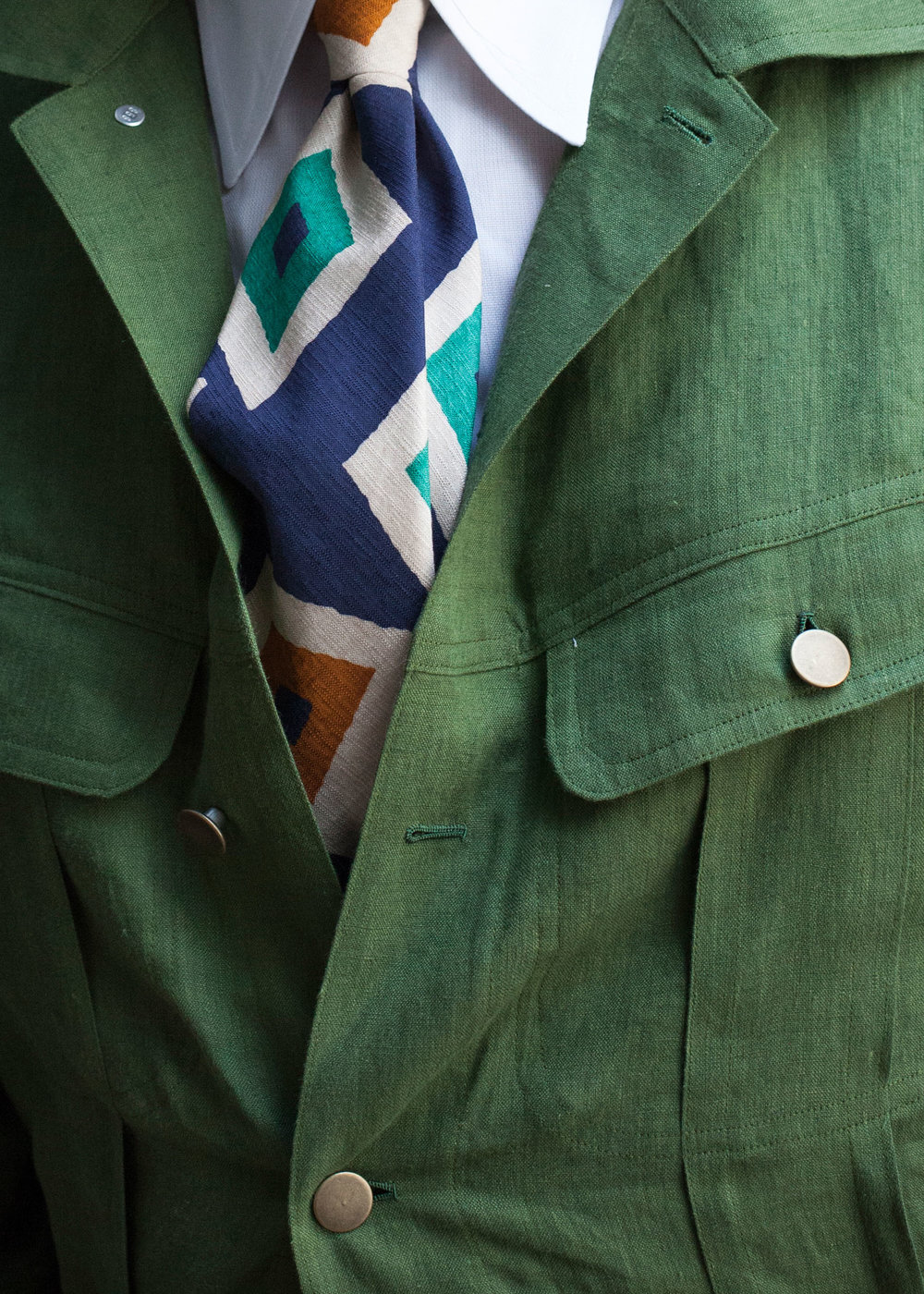 The rough texture, large pattern, and bright colors of this playful silk/cotton tie complements the casual vibe of Alan's bespoke linen trucker jacket.