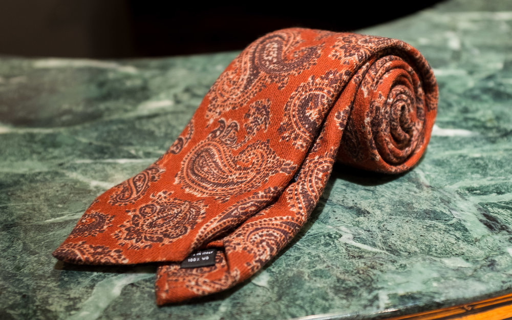 Printed Wool All-Over Paisley  - Although the paisley motif here is even larger and more ornate than the previous tie, a richly monochromatic palette renders this tie quite versatile and nearly as wearable as a solid.
