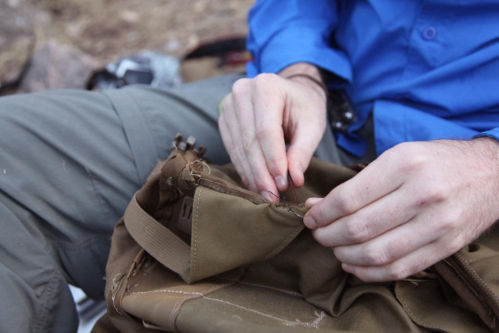 Sewing the shoulder strap back on
