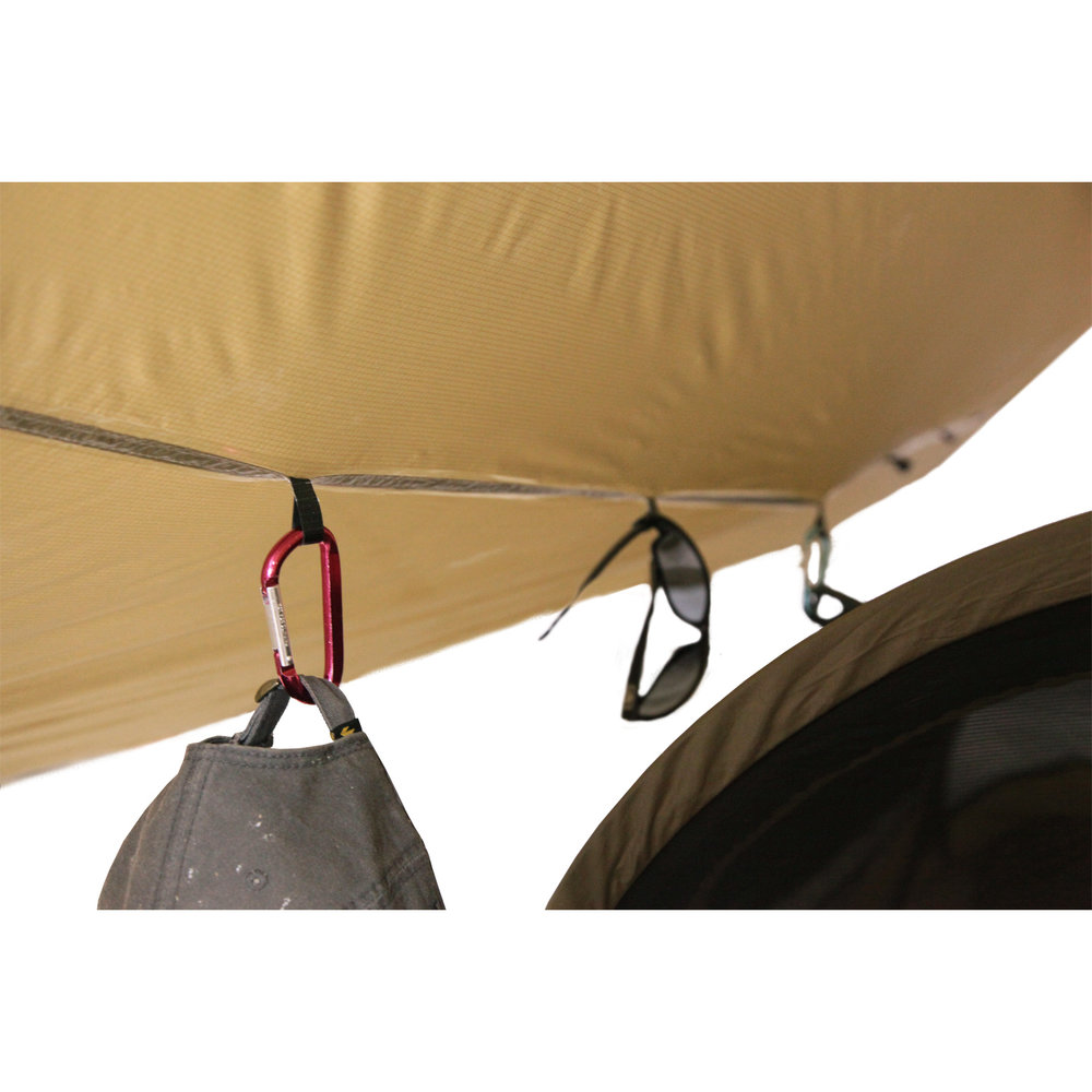 The tarp features plenty of gear loops for keeping your stuff off the ground.