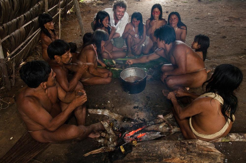 Pete enjoying a meal with the Huaorani tribe