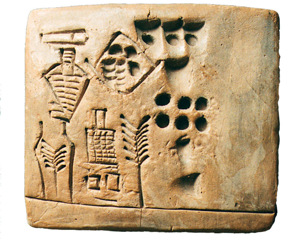 """Did You Know? The earliest human whose name has been recorded was an accountant! His name was Kushim, and he recorded a transaction on the tablet above, dated to 3100 BCE, which states: """"A total of 29,086 measures of barley were received over the course of 37 months. Signed, Kushim."""""""