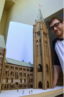 Mark Domanski, Surveyor of Signature Structures and the designer of Parliament, stands proud in front the mock-up of Centre Block and Peace Tower.
