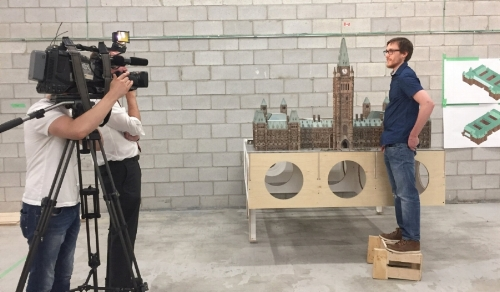 Mark standing proudly next to his design during the CTV Toronto shoot.