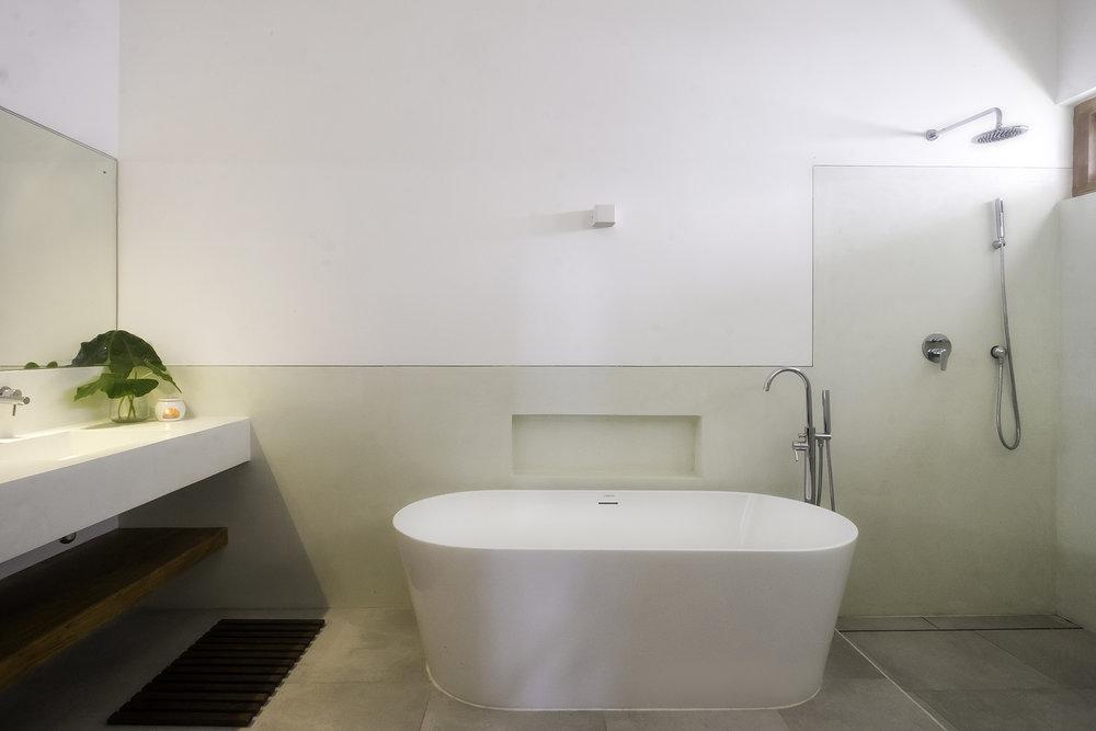 Ensuite of Bedroom 1 features a freestanding bath