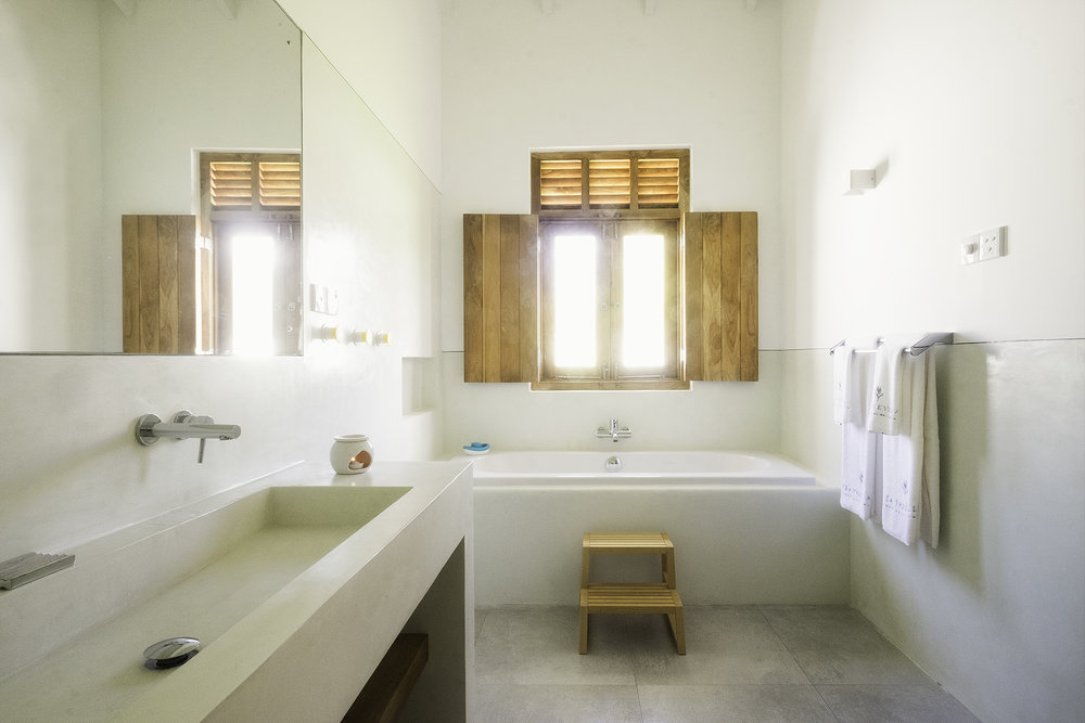 The Kids bathroom with a seperate bath and shower