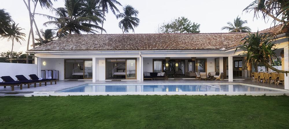 View of the house and expansive lawn from the beach