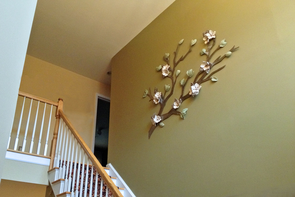 2-story entryway enhanced by a stainless steel branch and cream colored flowers 6'x4'