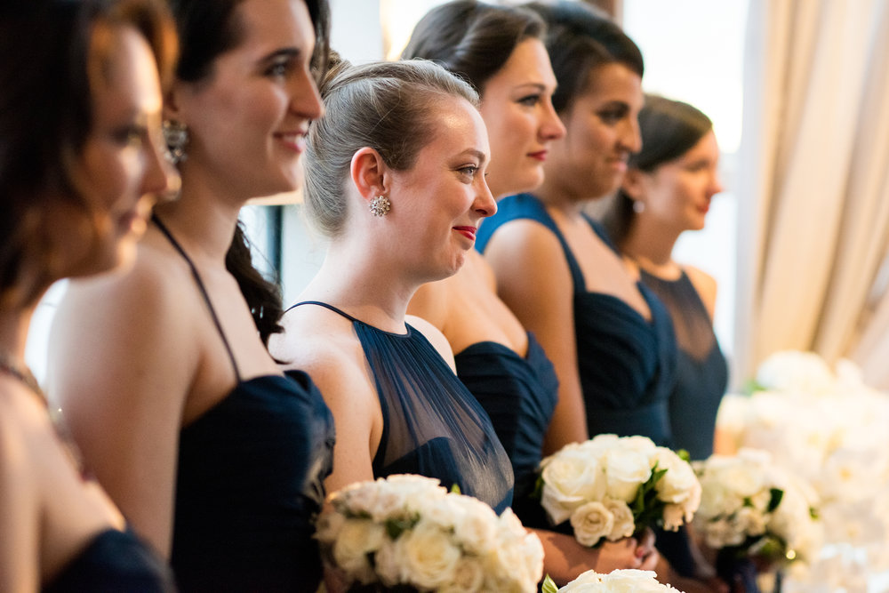 Navy bridesmaids dresses with white flowers