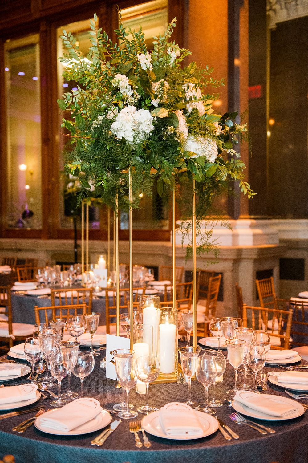 Elevated white and green centerpieces