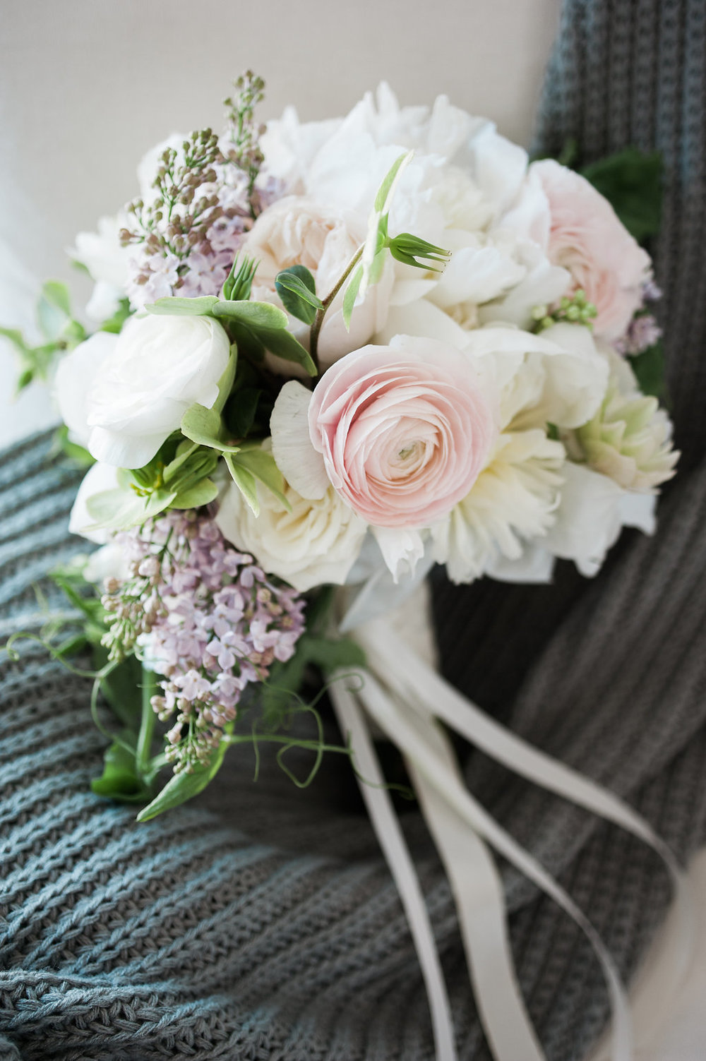 Spring bridal bouquet with lilac and peonies