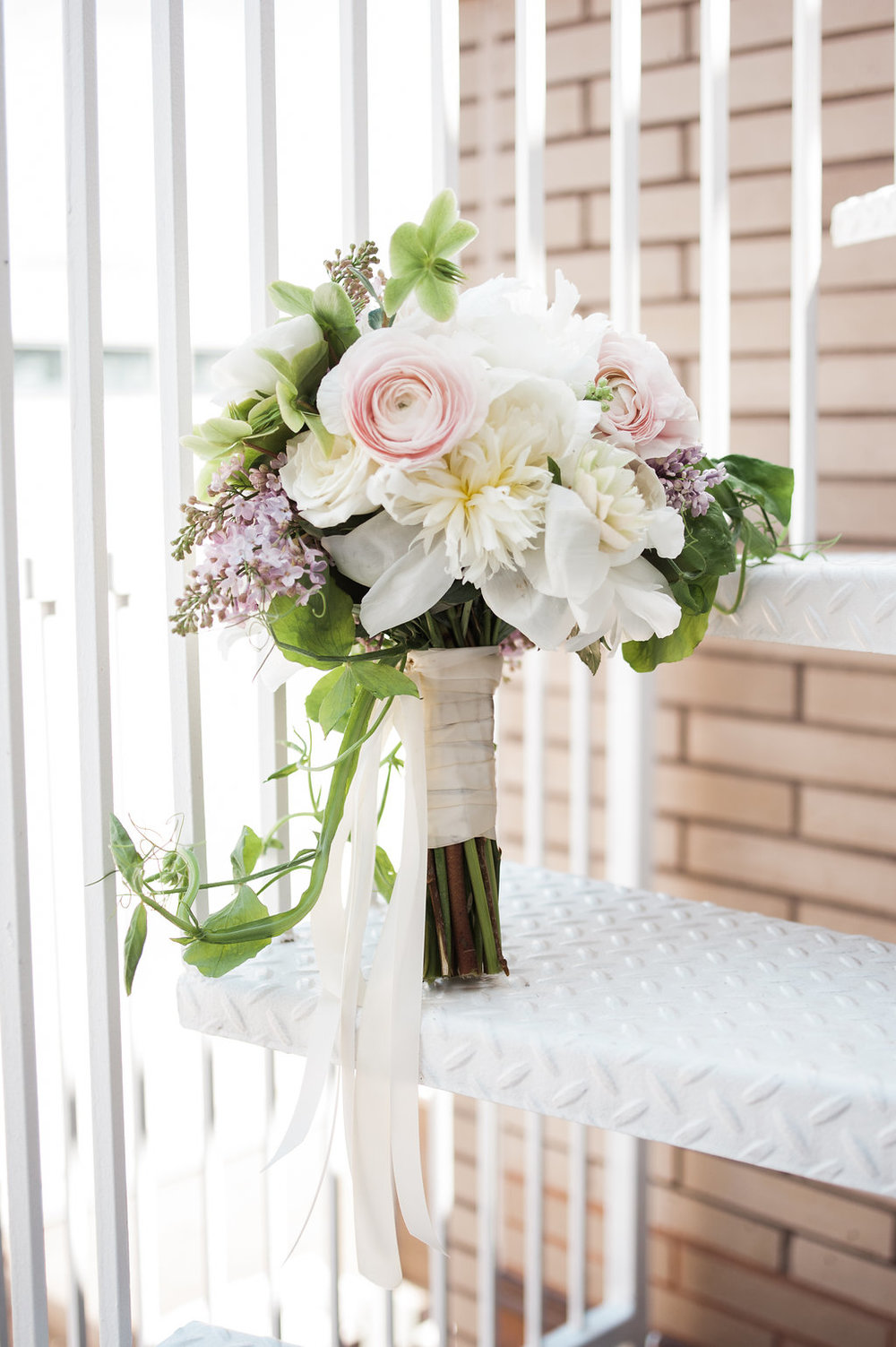 Spring bouquet with ranunculus and lilac