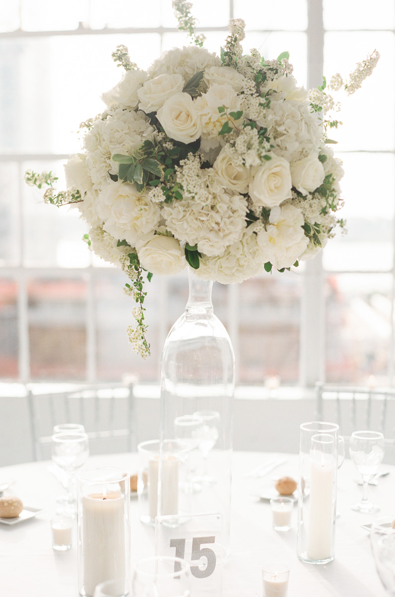 Tall white centerpiece with white roses