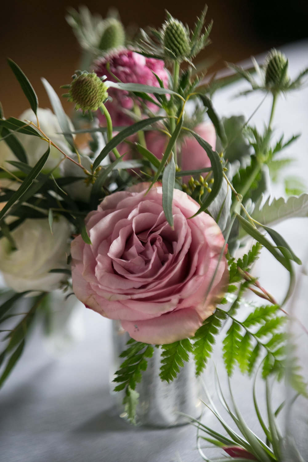 Thistle and rose centerpiece