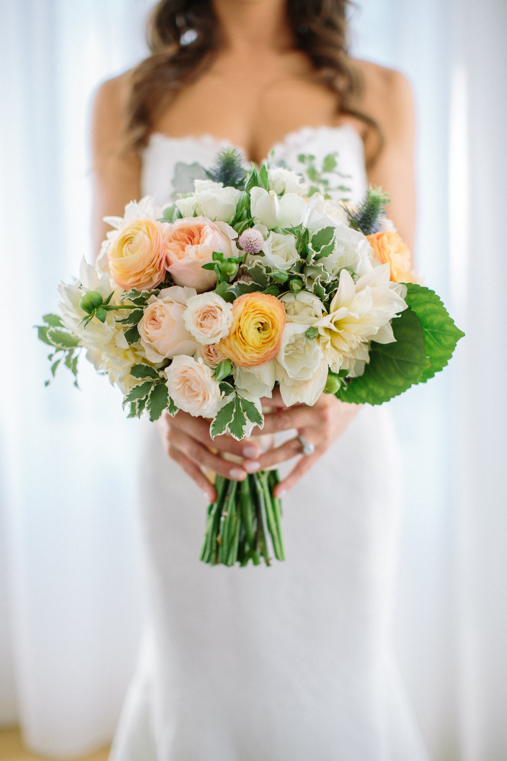 Coral and cream bridal bouquet