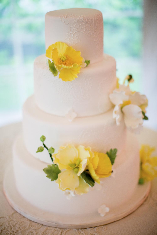 Yellow sugar flowers on cake