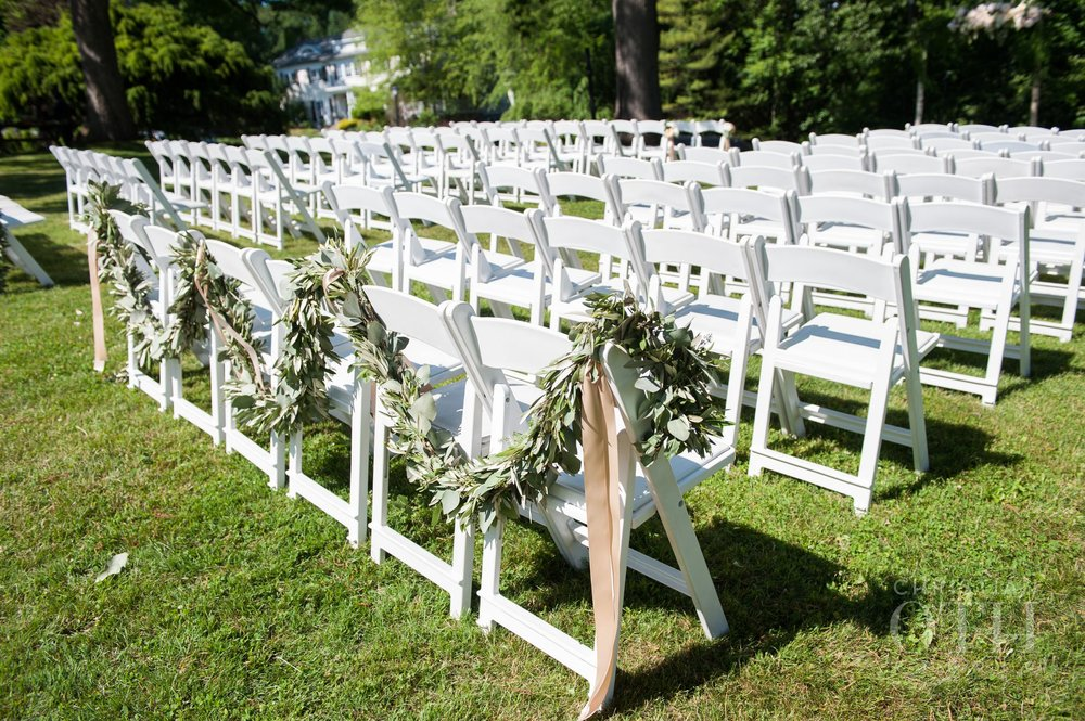 Green garland on chair backs
