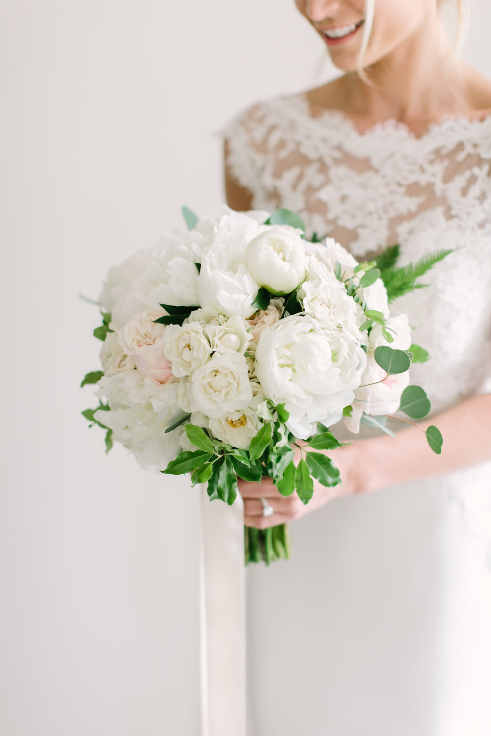 Bridal bouquet with white peonies