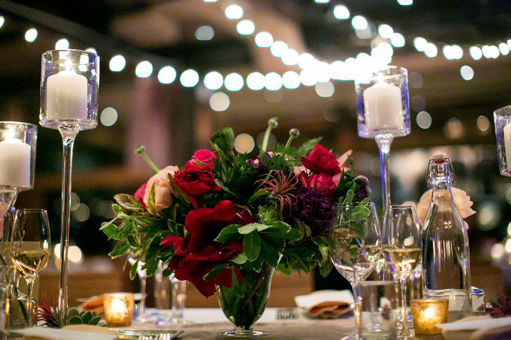 Jewel toned centerpiece and candlelight