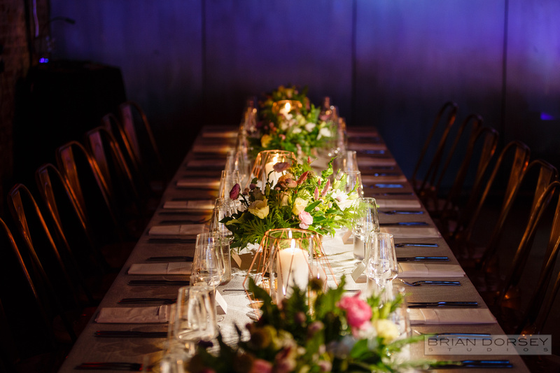 Long table centerpieces with geometric candles