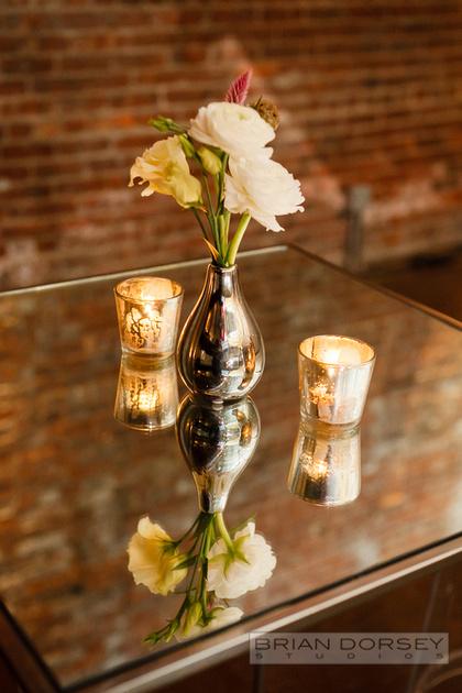 Silver bud vase with ranunculus