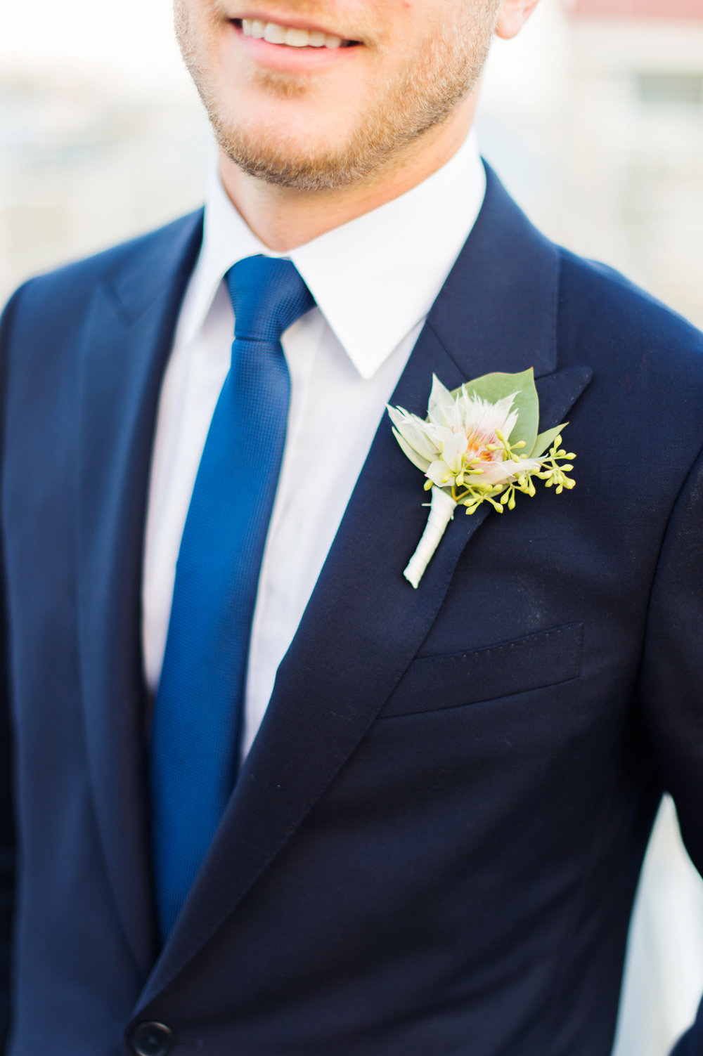 Blushing bride boutonniere groom