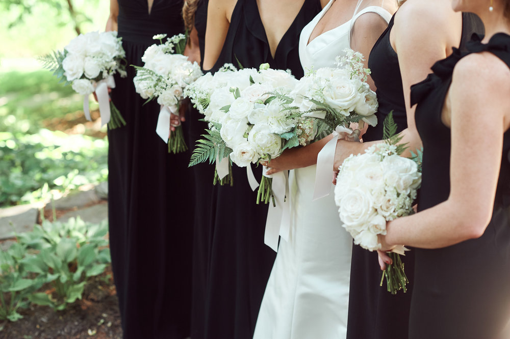 bride and bridesmaids bouquets in white and green