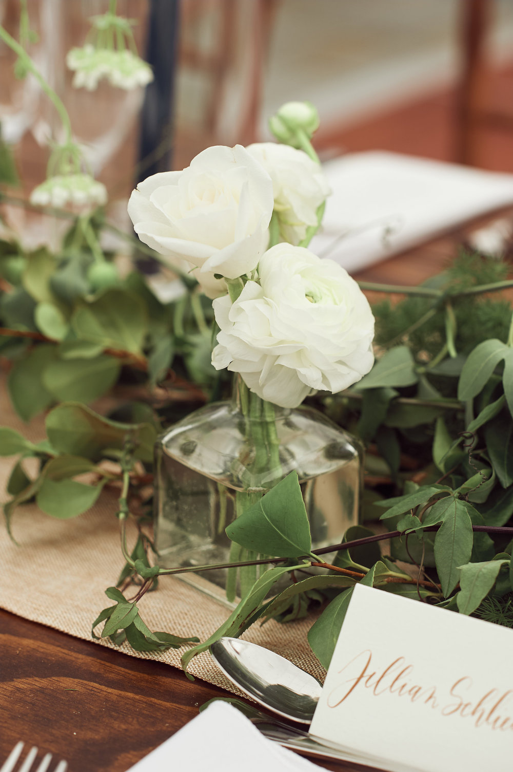 bud vases and custom seating card