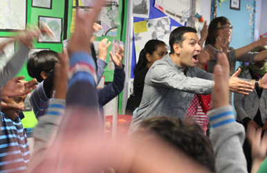 Darren Abrahams leads vocal warmup at Edith Neville Primary, Somers Town for the  Frankenstein  composition project
