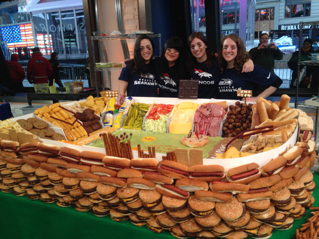 Good Morning America - Along with three other BuzzFeed editors I built a giant Snack Stadium (ie, piles of Super Bowl food in the shape of a stadium) on live TV. Jan 2014.