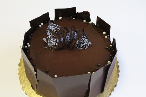 TRIPLE CHOCOLATE CAKE with layers of dark chocolate cake and dark chocolate mousse enveloped in a dark chocolate miroir glaze.