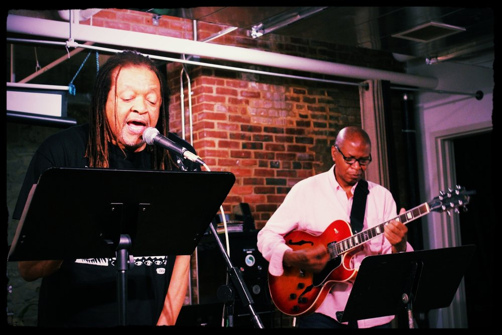 Photo Credit: Vanity Gee. Troupe and musician Kelvyn Bell performing at El Taller Latino Americano.