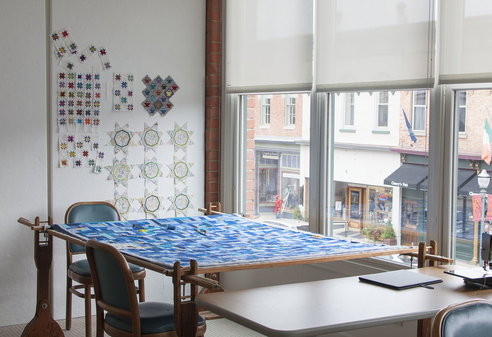 hand quilt frame by the window.jpg