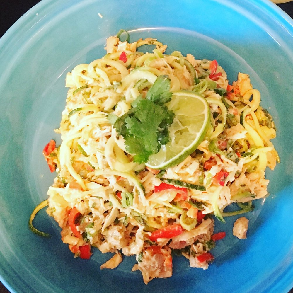 Pad Thai chicken salad with zoodles. Garnished with lime and fresh cilantro
