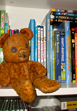 Many years later, Teddy is still with me. Here he is on a bookshelf in my office, where I see him every day.