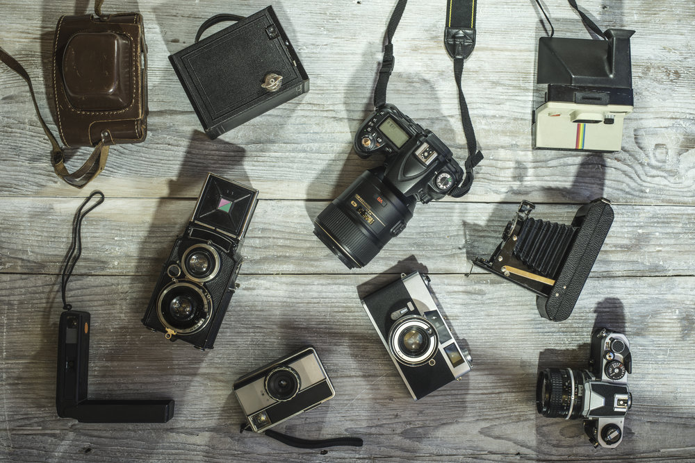 Set of vintage and new cameras