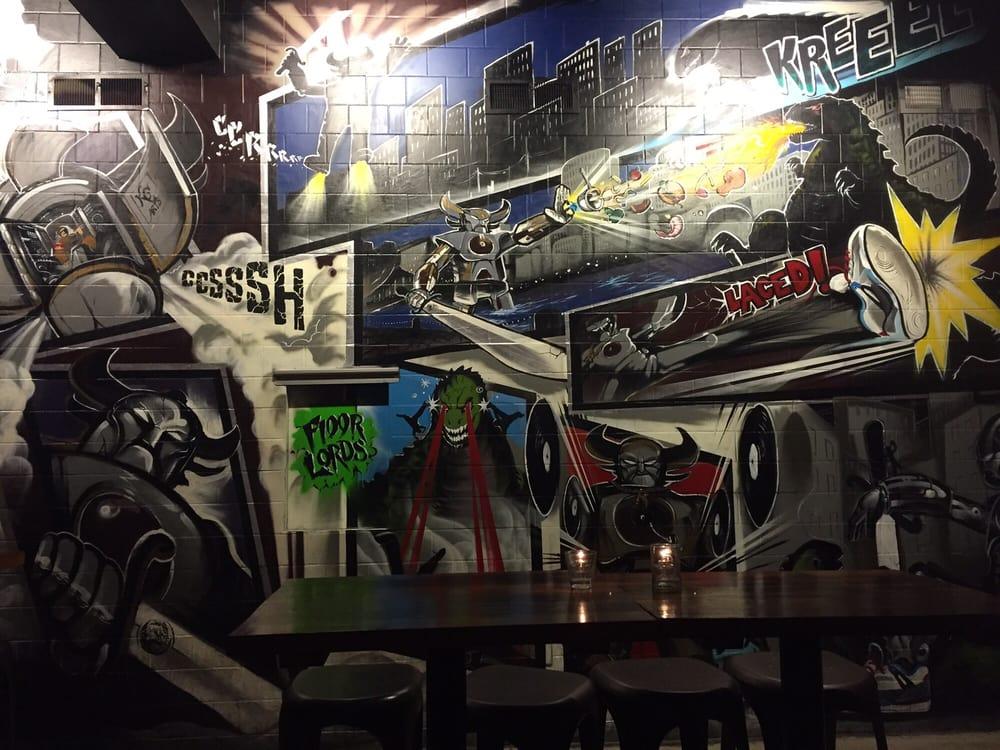 Comic graffiti of Robot vs. Godzilla? We're done here. (Rachel K, Yelp)