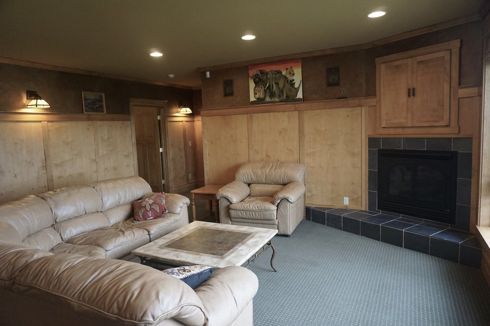 family room  with gas fireplace and hidden tv alcove