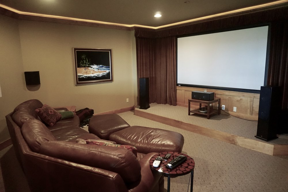 theater  (screen and projector included) with dropped crown molding and rope accent lighting