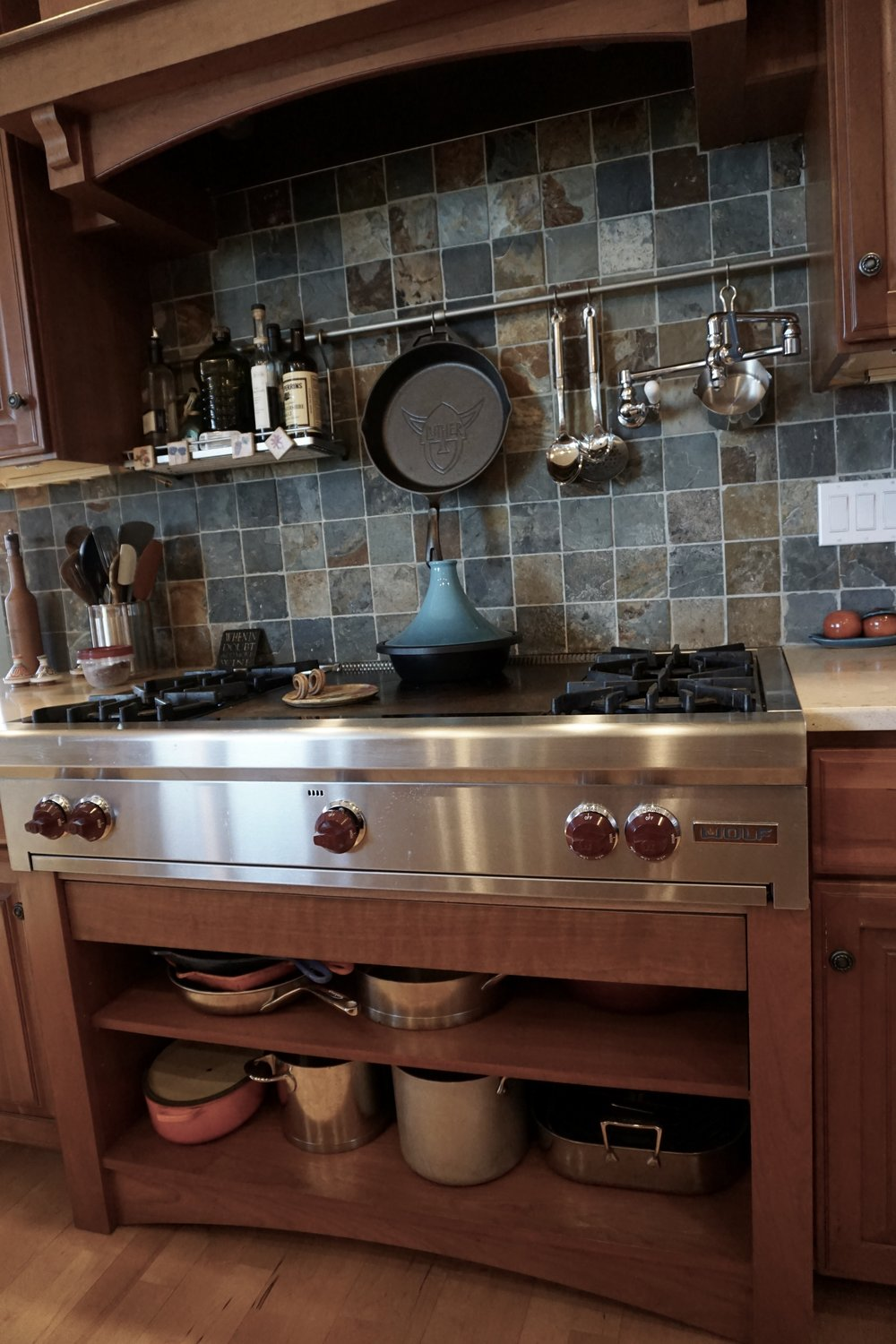 WOLF COOKTOP, POT FILLER FAUCET, OPEN POT STORAGE WITH LID DRAWER