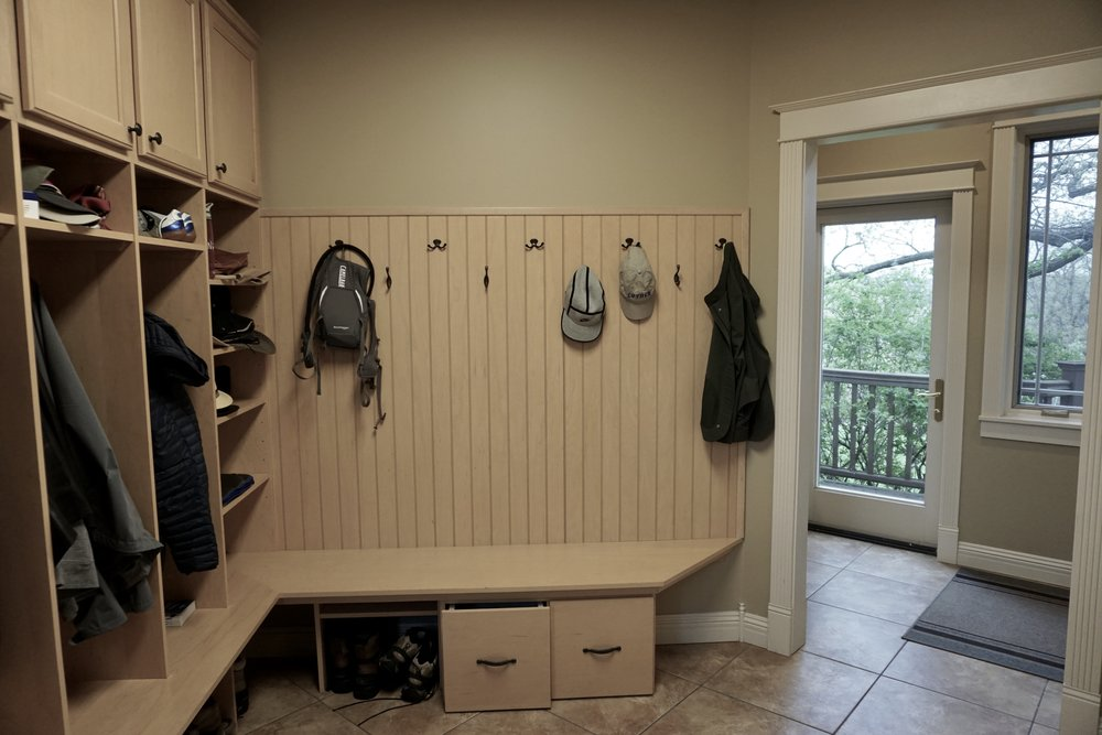 MUDROOM WITH FOUR OPEN LOCKERS AND WALL HOOKS